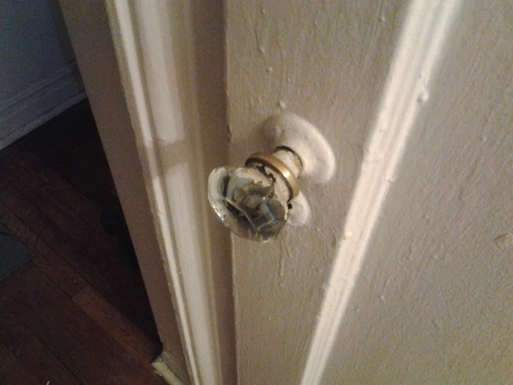 A closeup of a doorknob reveals a startling lack of detail from the camera.