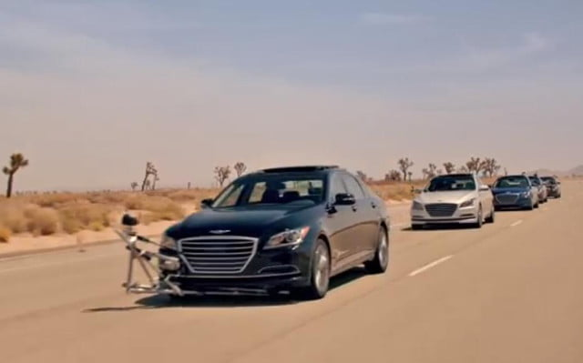 hyundai shows safety systems driverless stunt  genesis empty car convoy