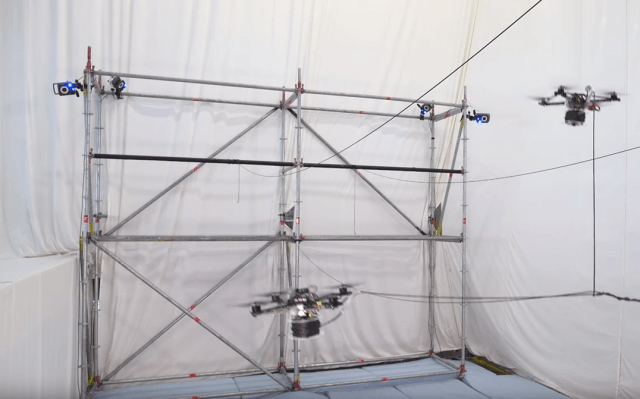 watch these drones build a rope bridge that can support human screen shot  at am