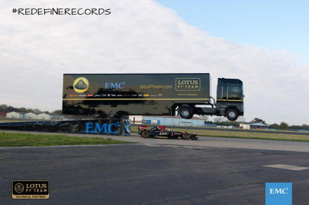 Renault truck jumps over moving Lotus F1 car