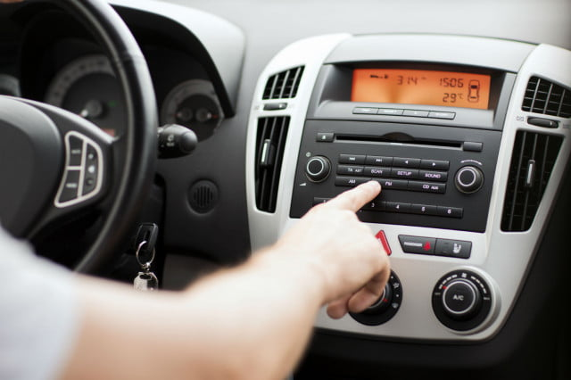nielsen report says most americans discover music from radio car