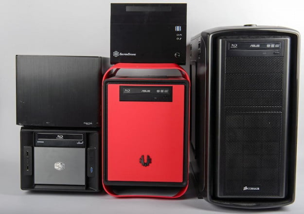 Four mini-ITX cases, next to a more traditional mid-tower PC case on the right.