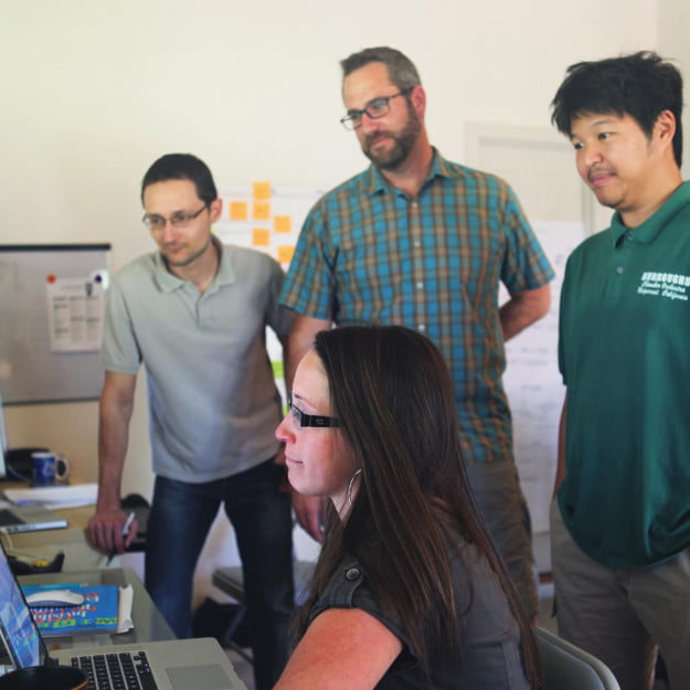 Chad Newell, a stock photo agency veteran and founder of Snapwire, reviews submissions with his team.