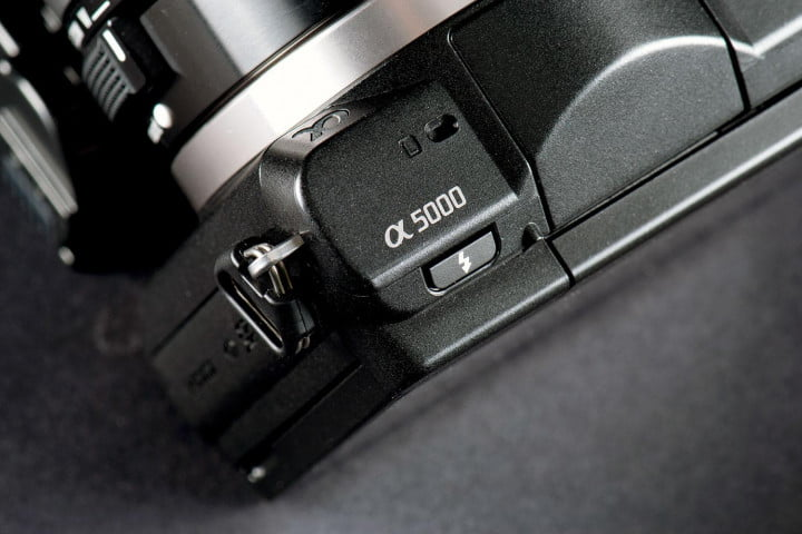 sony alpha a  review flash button