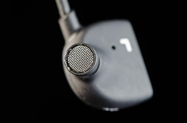 T Jays 4 in ear headphones left earbud macro