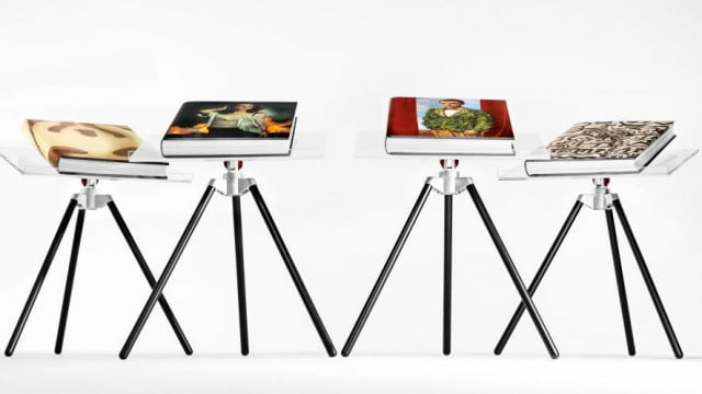Annie Leibovitz's new SUMO book from Taschen, shown in four different dust covers and on custom bookstands designed by Marc Newson. (Credit: Taschen)