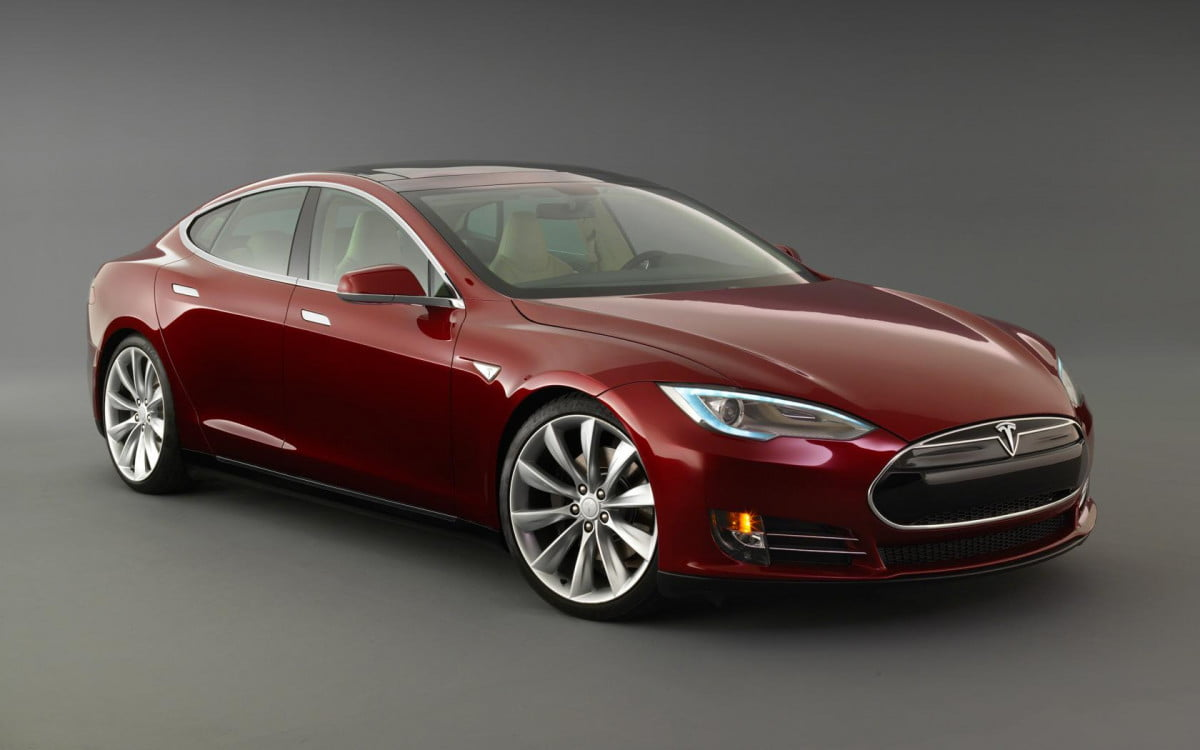 tesla model s goes  miles in the netherlands burgondy