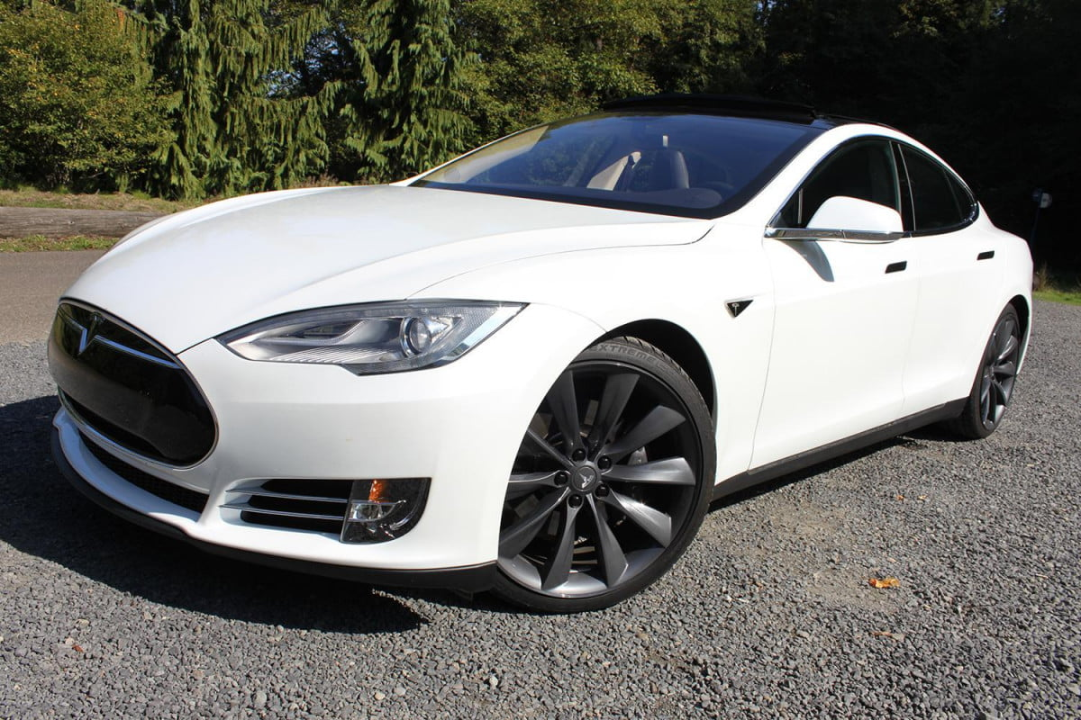 automotive revolutions  years apart how the past predicts future of driving tesla model s front left angle