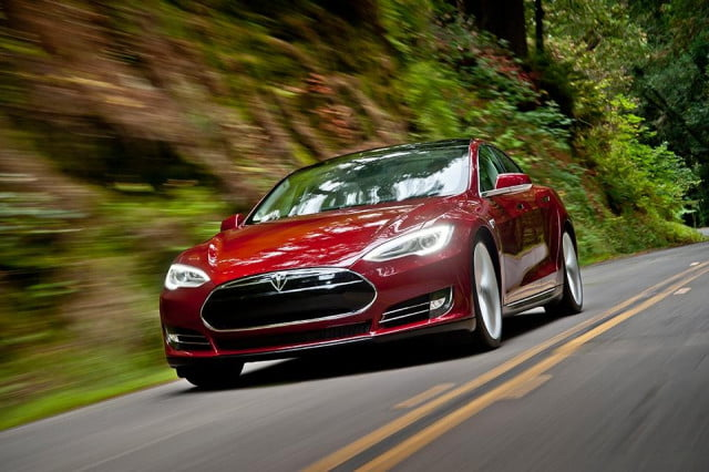 daimler wants more cooperation with tesla motors model s red on road
