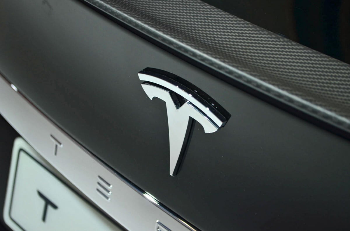tesla model e news specs rumors badge
