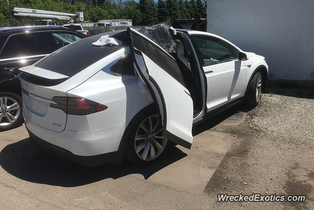 tesla model x falcon wing door ripped off with by garage