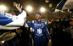 Dale Earnhardt Jr. celebrates on pit road after winning Sunday's rain-shortened NASCAR Sprint Cup Series Quicken Loans Race for Heroes 500 at Phoenix International Raceway. Jonathan Ferrey Getty Images