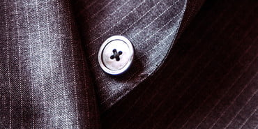 Button on a menswear garment, How to sew a button