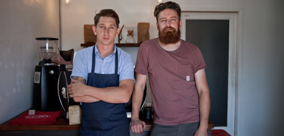 Owners Matt Bolick and Sterling Roberts inside Flat Track Coffee