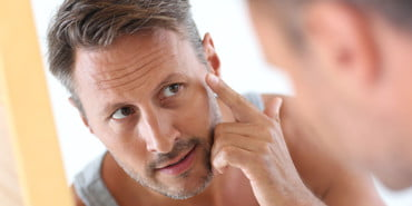 Generic-Man-Putting-on-Lotion, best face moisturizers