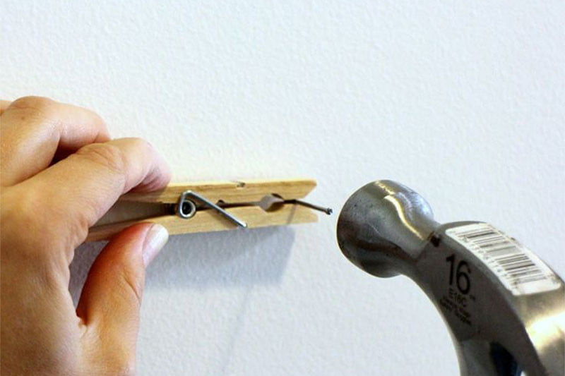 hacks hanging picture frames nail clothespin