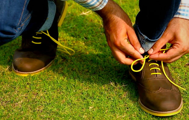 casual brogue on feet with grass