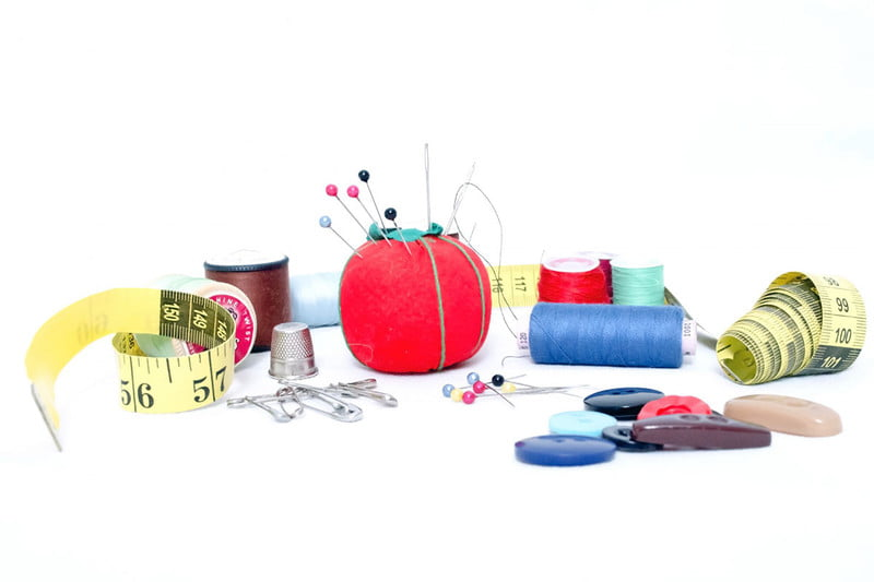 Sewing kit with pin cushion, needles, and thread