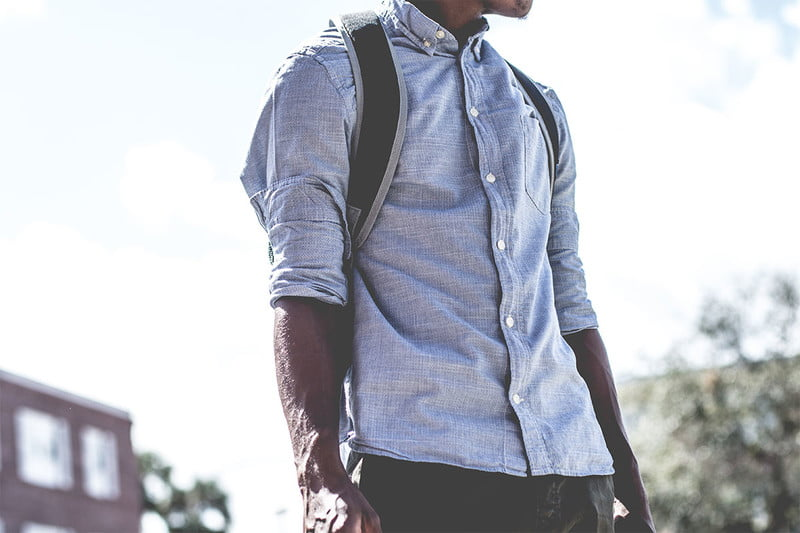 Man with backpack and button-front shirt