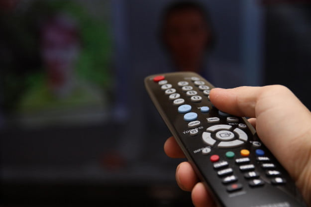 tv hand remote shutterstock
