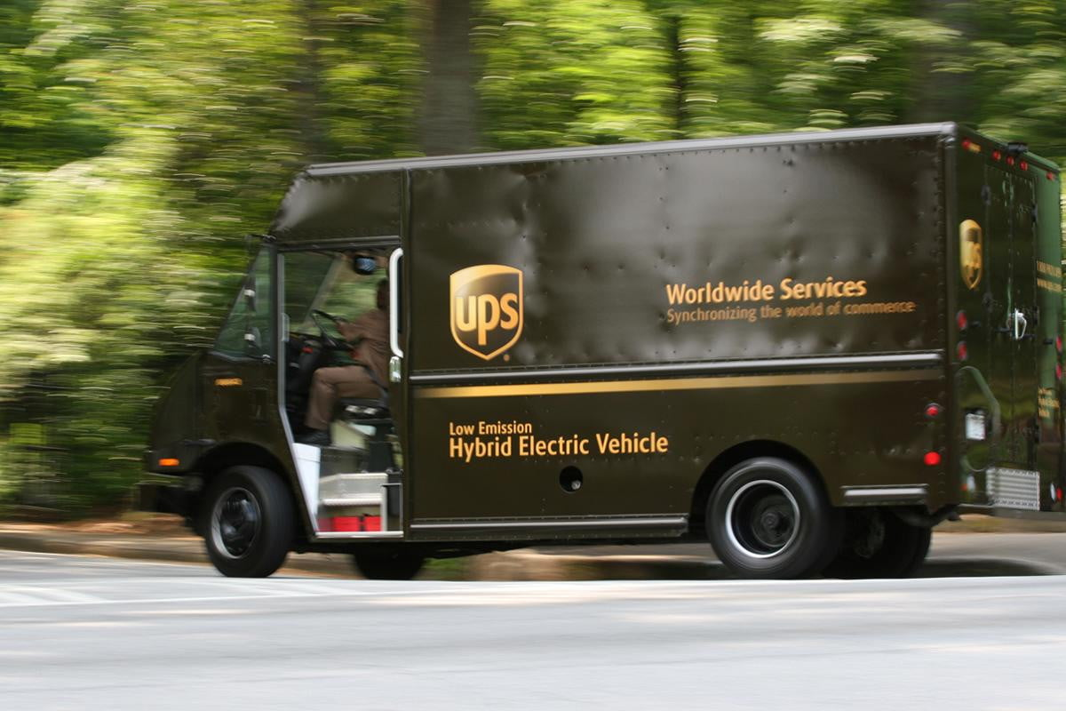 ups driver leaves tablet in trash can truck driving