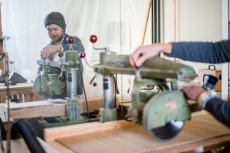 Sam Beck prepares his vintage saw for cutting bamboo panels