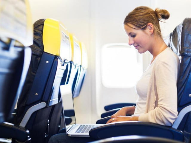 flight attendants rather gadgets stayed switched woman on plane with laptop