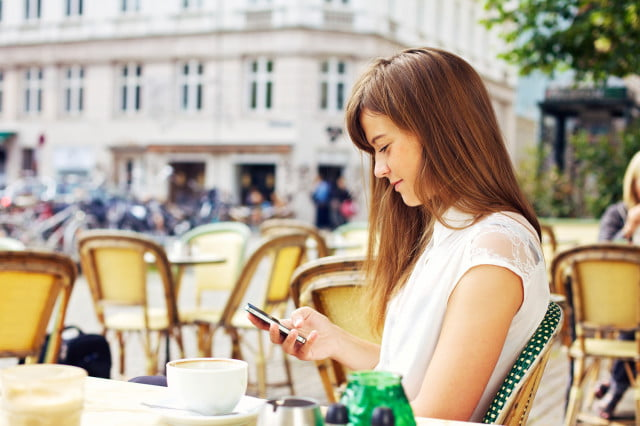 researchers track pedestrian patterns via their wi fi usage woman texting on smartphone