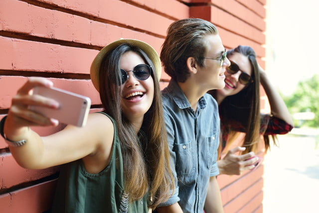 algorithm tells age instagram activity young people having fun outdoor and making selfie with smart pho