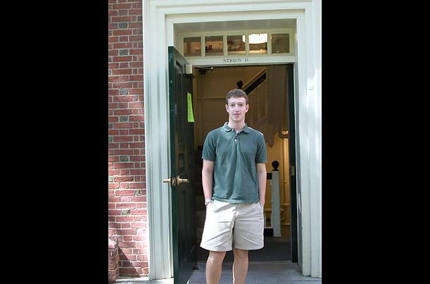 Mark standing outside his freshman dorm