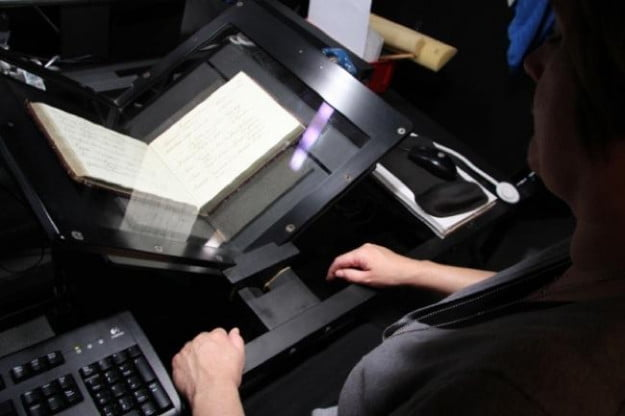 Getty Research Institute's Richinda Brim uses scanning equipment for digitizing pieces from Getty's collection. (J. Paul Getty Trust)
