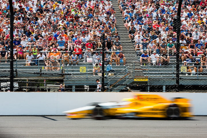 Spencer Pigot flies past the front stretch grand stands during the 100th running of the Indianapolis 500