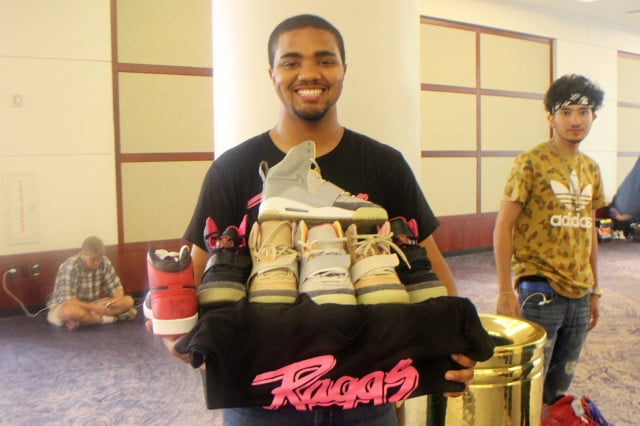 Karon Smith, owner of Raggs Boutique, holding $10,000 worth of sneakers