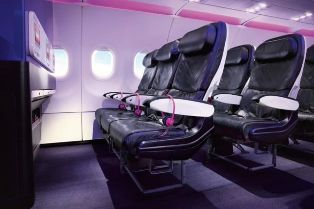 Bulkhead seats offer generous legroom, but lack space in front to store a carry-on bag. Some airlines charge for these seats.